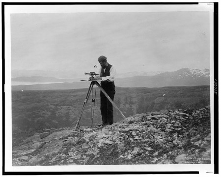 Surveyor-with-theodolite-in-the-mountains-of-Alaska,-1899